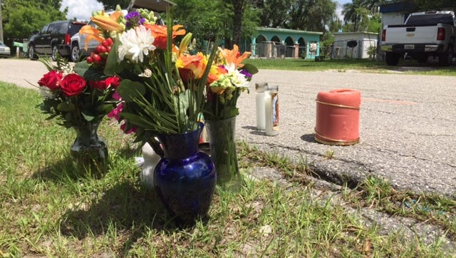 A small memorial to Alondra Karina Zavala-Garcia,7, of Jupiter Road in Fort Myers has grown since she was killed after being hit by a van Saturday night while riding her tricycle. Her home is in the background