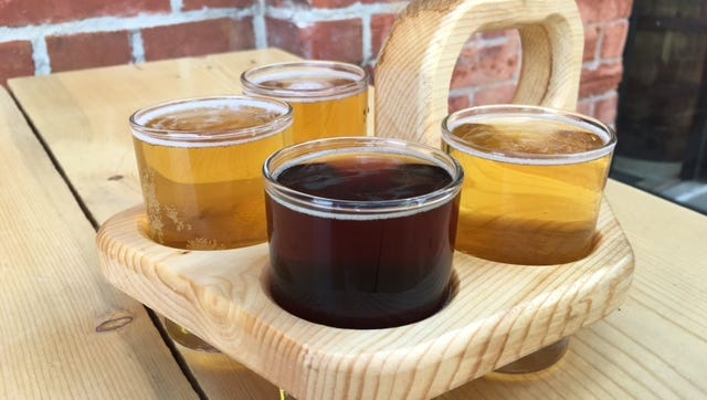 A tasting flight of beers served at Prost Brewing Co.'s taproom in Old Town Fort Collins.