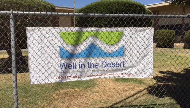 The Well in the Desert's new sign outside their new location at 588 Rosa Parks Road Friday, July 22, 2016.