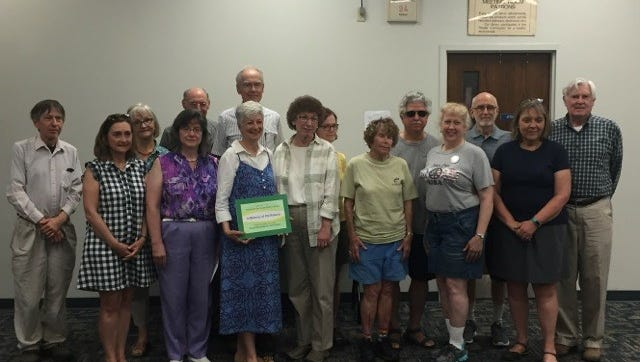 Members of VeRSE present an envelope with money totaling $1,000 as a gift to the Friends of the Vestal Public Library.