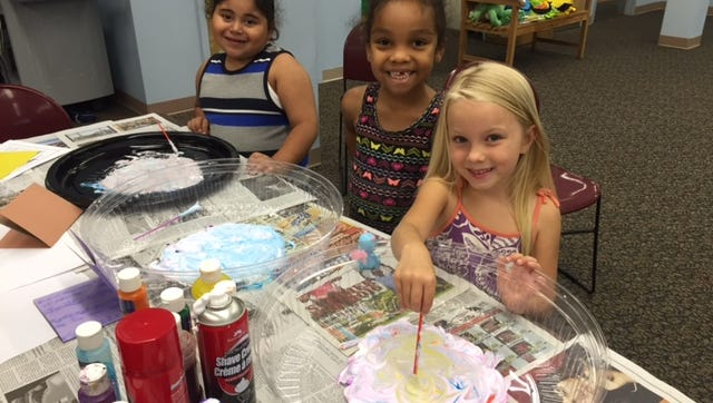 Artists (from left) Imanol Leal, Ja'Nelle Rivera and Holly O'Donnell work on their entries for an art show that's scheduled to open Aug. 10 at Cumberland County Library, 800 E. Commerce St., Bridgeton. For information on library programs, call (856) 453-2210 or visit www.CCLNJ.org.