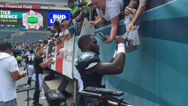 Wendell Smallwood signs autographs after Eagles practice Sunday at Lincoln Financial Field.