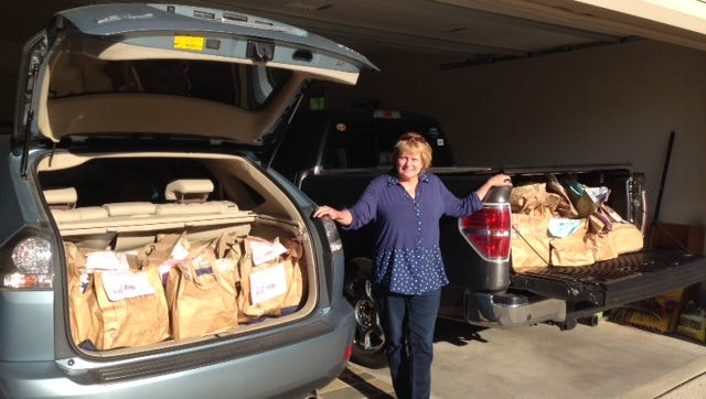 Lynn Jenkins poses with some donations for the Fondy Food Pantry.