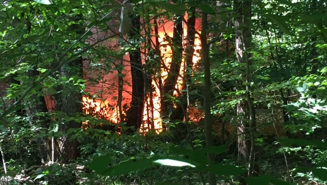 Flames from the site crashed small airplane Monday afternoon in Chenango County. Four people who were aboard all escaped without major injury.