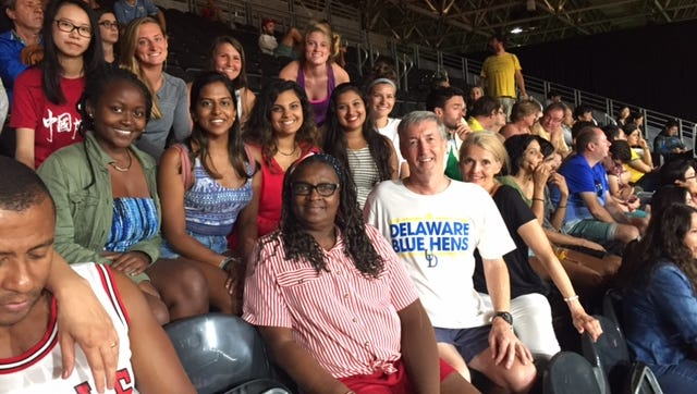 UD professor Steve Goodwin, front and center in his Blue Hens T-shirt, with his study-abroad class at Olympic badminton Monday.