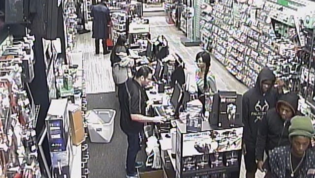 A surveillance photo shows three young men who tried using a stolen credit card June 28 at the Game Stop store in Edison Mall.