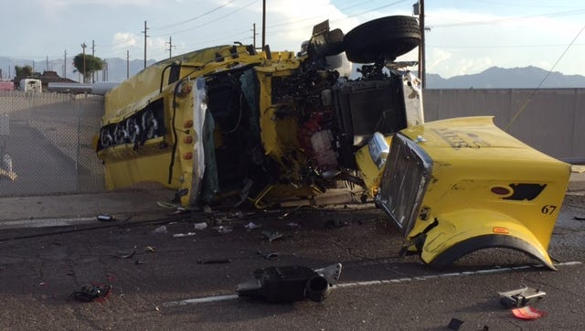 A semi truck and a vehicle collide at 59th Avenue and Buckeye Road.