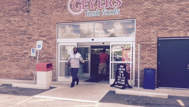 Customer Ben James exits the Geyer's grocery store on South Diamond Street after learning the grocery, the only one in operation on Mansfield's near southeast side, will shut down  at the end of this week.