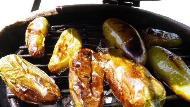 Roasted jalapenos on the grill to be used in a homemade salsa
