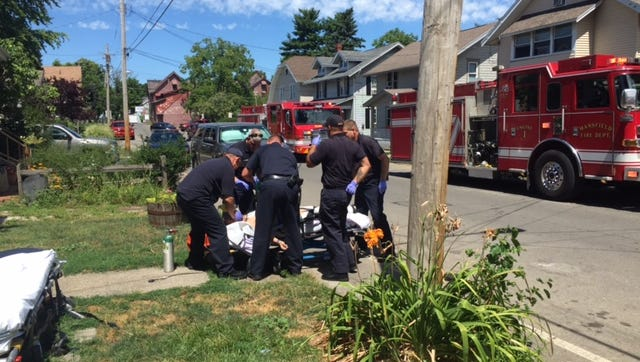 Mansfield firefighters/rescue personnel attempt to revive a drug overdose patient on Bartley Avenue Aug. 8. She later died at the hospital.