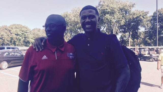 Detroit Mercy basketball coach Bacari Alexander and Jalen Rose on Monday at the Jalen Rose Leadership Academy celebrity golf outing.