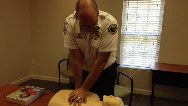Lt. Jason Walchok of Greenville County EMS demonstrates Hands-Only CPR
