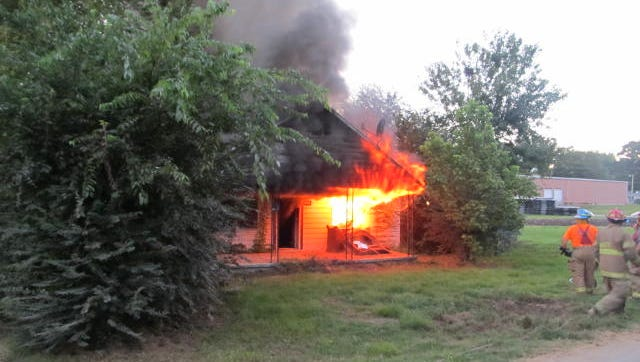 Huntingdon firefighters did a controlled burn of a condemned wood-frame house on Woodlawn Street on Monday.