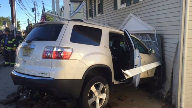 An SUV was hit from behind and crashed into a Main Street building in Sparta.