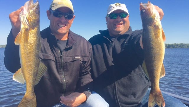 Mike and Jay Zalinski with a pair of nice walleyes.
