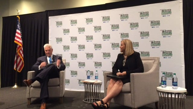 HCA CEO Milton Johnson shares the stage with Mayor Megan Barry.