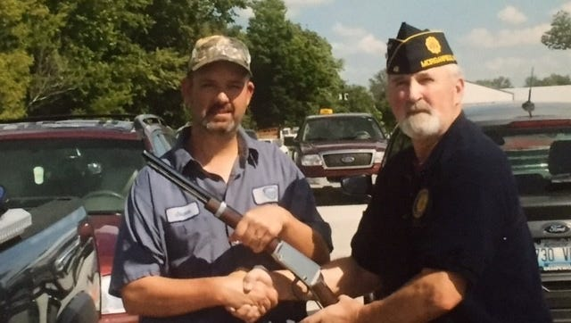 Pictured is Griggs-Alvey American Legion Post #48 Sergeant-at-Arms Harvey Messer presenting a Henry rifle to Jason Williams.  The rifle drawing was a fund raiser for Post # 48.