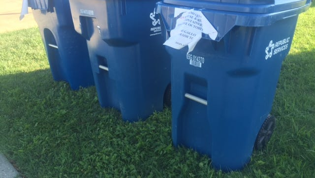 Three of Republic Services' new 65-gallon trash containers sit in front of the Fremont Fire Department. The city is opening bids for a new trash removal contract.