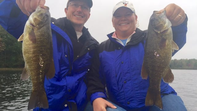 Tal and Darlene Janowitz with a couple Hayward area smallmouth bass.