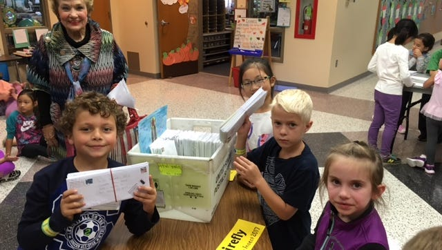 State Rep. Sheila Klinker visited Maggie Samudio's second-grade class Tuesday as they prepared to mail letters asking people to support their petition to adopt the Say's firefly as Indiana's state insect.