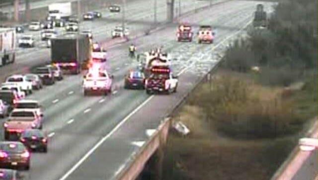 Metal debris closed down three lanes of Interstate 64 north Friday morning.