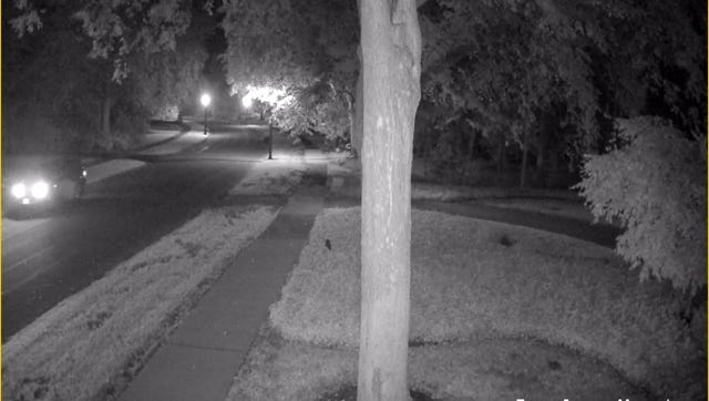 DO NOT USE. SOURCE HAS FORBID USE  Security footage shows a vehicle stopping at driveways along Sandringham Road in Brighton early Thursday morning before residents awoke to white supremacist fliers placed in driveways overnight.
