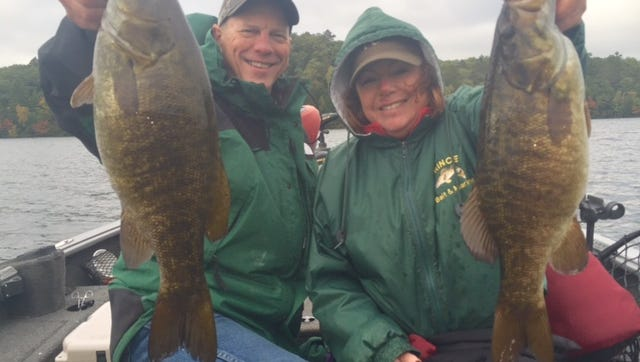 Kirby and Susan Krischke with a pair of Chequamegon Bay smallmouth bass.