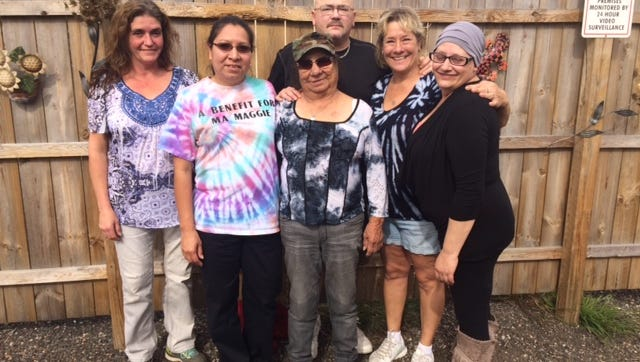 Maggie Mayka, third from left, stands with some of the family and friends hosting a benefit in her honor this weekend. She has been battling stage four lung cancer for two years.