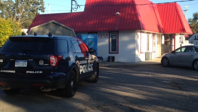 Lansing police were looking for three men who staged a robbery at a party store in West Saginaw Street Thursday evening.