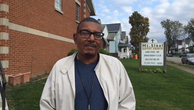The Rev. Laurence Rawls of Mount Sinai Baptist Church welcomes those in need to come to the food pantry, which is open the third Saturday of each month from 1 to 3 p.m.