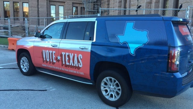 Secretary of State Carlos Cascos' vehicle is a rolling billboard to encourage voting.