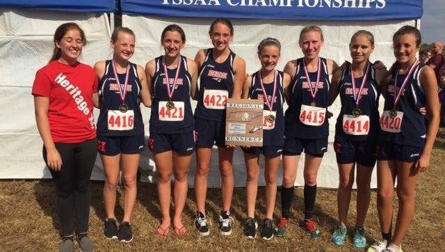 The White House Heritage girls cross country team poses with the region runner-up plaque.