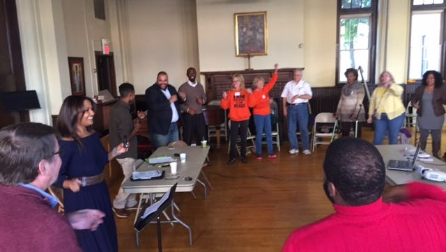 """Panelists and atendees dance for a """"brain break"""" during a panel discussion on violence in schools. The event was held at the Episcopal Church of Saints Andrew and Matthew in Wilmington on Saturday."""