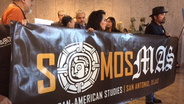 A Mexican-American studies banner from San Antonio was displayed outside the State Board of Education meeting room.