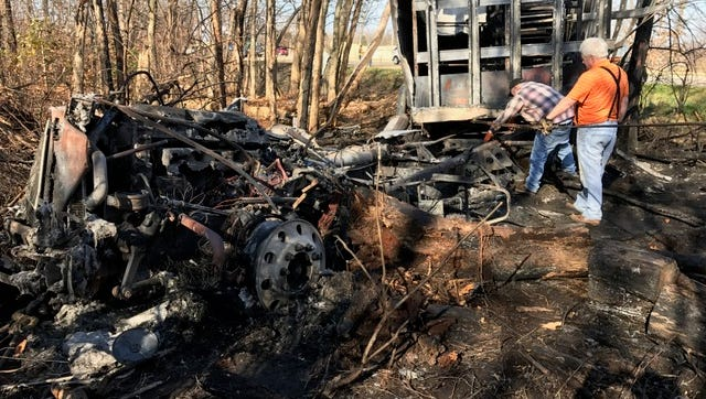 The burned wreckage of a semi truck after a crash Friday morning on I-94 near Exit 92.