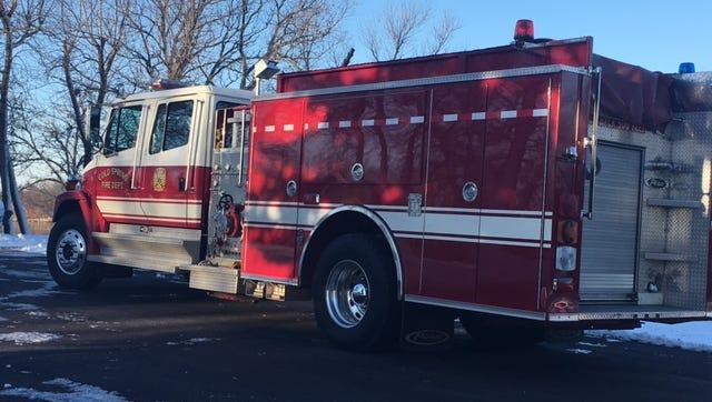 A fire truck waits to assist during a house fire near Richmond Monday, Nov. 21.