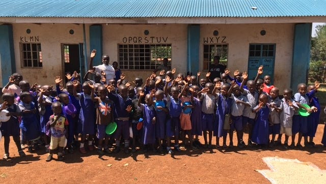 Students in Dago, Kenya stand in front of the village's school waiting for lunch.