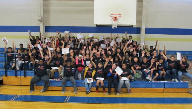 Fifth-grade students at Huntingdon Middle School celebrate their graduation from the DARE program.