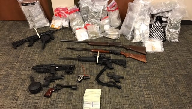 Police seized guns, pills and marijuana in a drug bust Dec. 1, 2016.