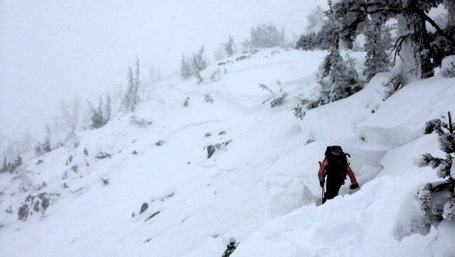 This photo shot Saturday, Dec. 10, 2016, of the crown, or top, of a skier-triggered avalanche at Mt. Rose Ski Tahoe shows how the slide stepped down through multiple weak layers of snowpack. The avalanche occurred in a closed area of the resort. The skier thought to have triggered it was buried and had not yet been recovered nearly 24 hours later. The avalanche was 350 feet wide, moved 1,000 feet and was as deep as 10 feet in places.