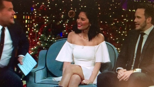 "Chris Pratt, right, and Olivia Munn, tell the host of ""The Late Late Show with James Corden"" about what happened when Pratt tried to impress Aaron Rodgers while manning the grill."