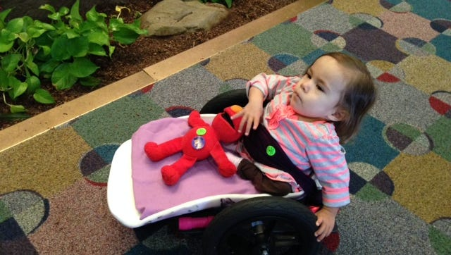 Little Valerie Cancino gets around in a specially designed wheelchair at Shriners Hospital for Children in Greenville.