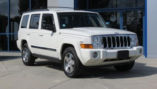 Detectives are seeking a white 2010 Jeep Commander, like the one pictured, with the license plate VEJ421. The vehicle was reportedly stolen.