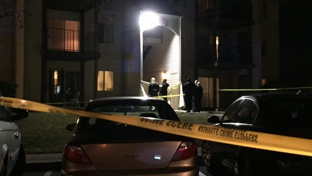 Police investigate a fatal shooting at Chimney Top Apartments Dec. 30, 2016.