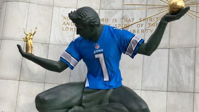 The Spirit of Detroit statue in downtown Detroit sports a Detroit Lions jersey.