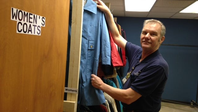 Ben Noblitt at the clothing closet he established for the needy at St. Francis.