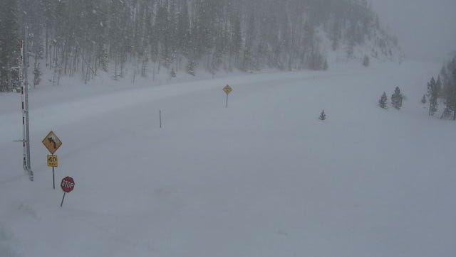 Snow covers the road at Cameron Pass along Colorado Highway 14 on Wednesday.