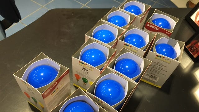 Blue light bulbs were handed out Friday night at Graham Automall during the Richland County 2017 Spread the Light event honoring law enforcement and first responders.