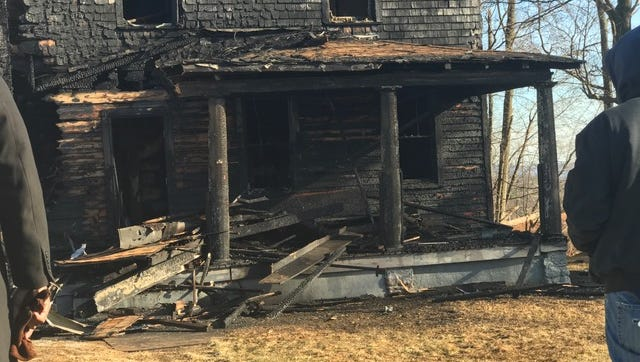 Fire destroyed this house at 18 Slinn Ave. in Spring Valley on Friday morning. Authorities are looking at an accidental origin caused by a cigarette butt.