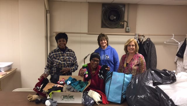 Nina Young (seated), Gateway's Code Blue Coordinator, accepts a donation of gloves, hats, socks, scarves and hand warmers from (standing, from left) Alberta Frazier, Carole Fischer and Debby Brooks on behalf of Soroptimist International of Cumberland County.